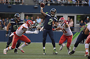 Aug 25, 2017; Seattle, WA, USA; Seattle Seahawks quarterback Trevone Boykin (2) throws a pass under pressure from Kansas City Chiefs linebacker Earl Okine (44) and outside linebacker Frank Zombo (51) during a NFL football game at CenturyLink Field. The Seahawks defeated the Chiefs 26-13.