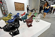 HONG KONG - MARCH 13:  A visitor takes a picture of colorful sculptures 'Horse' by Ai Weiwei on display in art fair Art Basel on its preview day on March 13, 2015 in Hong Kong, Hong Kong.  (Photo by Lucas Schifres/Getty Images)