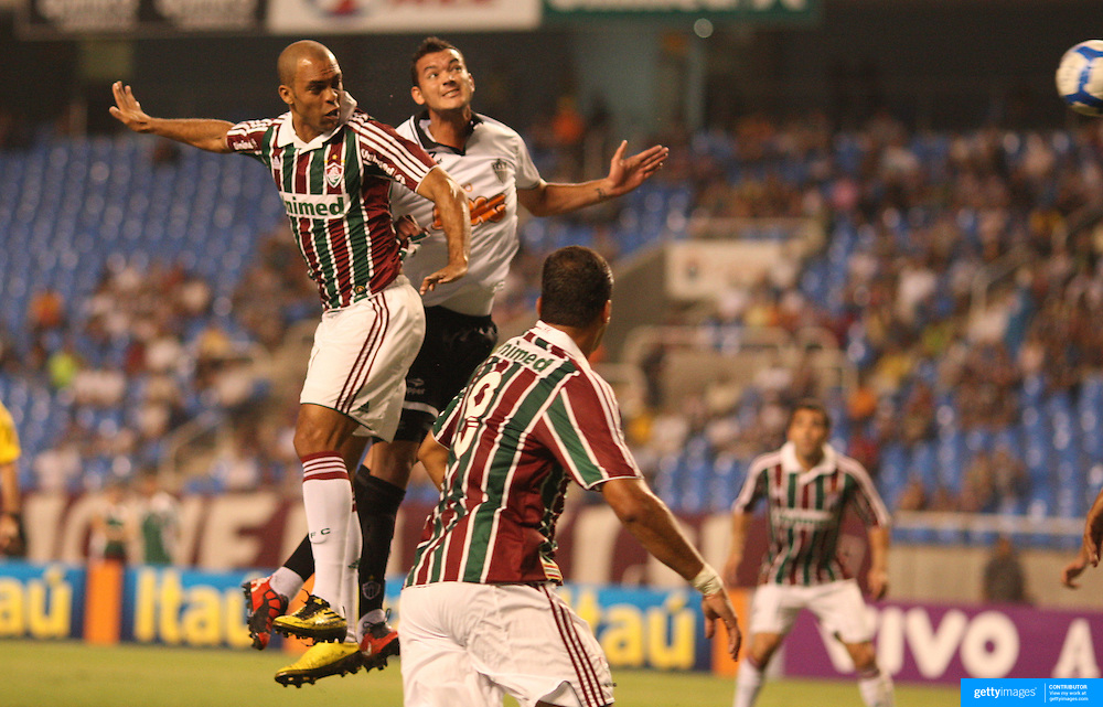 Leandro (left) scores his sides first goal with a header during the  Fluminense VAtlético MG, Futebol Brasileirao  League match at Estadio Olímpico Joao Havelange, Rio de Janeiro, Fluminense won the match 5-1. Rio de Janeiro,  Brazil. 23rd September 2010. Photo Tim Clayton.