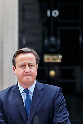 """© Licensed to London News Pictures. 13/11/2015. London, UK. Prime Minister David Cameron giving a statement in Downing Street on British-born ISIS terrorist Mohammed Emwazi, dubbed as """"Jihadi John"""", after he was reportedly killed in a US drone strike. Photo credit: Tolga Akmen/LNP"""