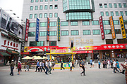 Scene in the shopping district of Wangfujing in Beijing, China. Wangfujing, located in Dongcheng District, Beijing, and is one of the Chinese capital's most famous shopping streets. The majority of the main shopping area is pedestrianised and is very popular for shopping for both tourists and residents of the capital.