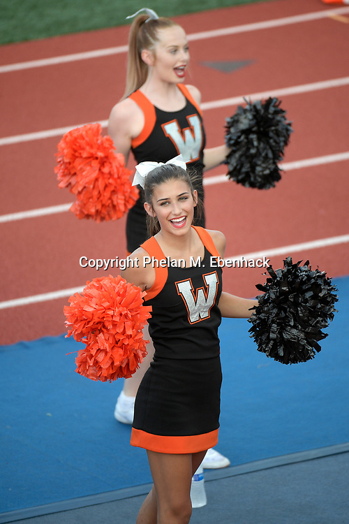 Winter Park cheerleaders perform during the first half of a high school football game against Wekiva Thursday, Sept. 7, 2017, in Winter Park, Fla. (Photo by Phelan M. Ebenhack)