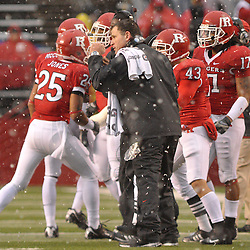 Dec 5, 2009; Piscataway, NJ, USA; Rutgers head coach Greg Schiano celebrates a defensive turnover with his team during second half NCAA Big East college football action in West Virginia's 24-21 victory over Rutgers at Rutgers Stadium.