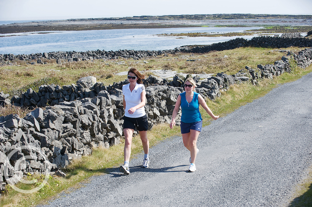A weekend of glorious weather welcomed approximately 150 people from all over the country and abroad to Inis Mor , Arann Islands to participate in the annual Aer Arann half marathon.  Over the past ten years people have walked and ran the roads of Inis Mor to raise in excess of 1.2 million to purchase vital life saving equipment for sick children in both Crumlin and Temple Street hospitals.  Aer Arann Staff Grainne McDonagh and Maire Seoighe took part  . Photo:Andrew Downes.