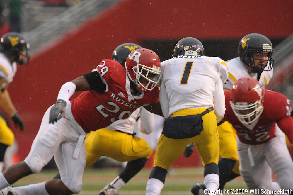 Dec 5, 2009; Piscataway, NJ, USA; Rutgers cornerback Zaire Kitchen (29) tackles West Virginia wide receiver Tavon Austin (1) during second half NCAA Big East college football action in West Virginia's 24-21 victory over Rutgers at Rutgers Stadium.