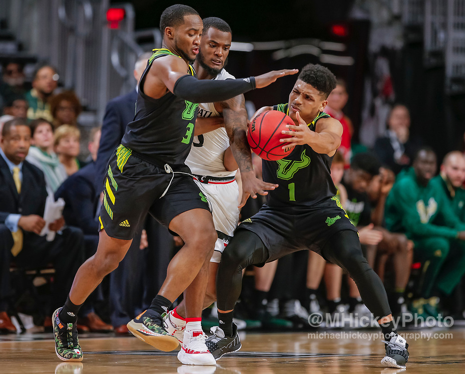 CINCINNATI, OH - JANUARY 15: LaQuincy Rideau #3 and Xavier Castaneda #1 of the South Florida Bulls battle for the ball against Trevor Moore #5 of the Cincinnati Bearcats at Fifth Third Arena on January 15, 2019 in Cincinnati, Ohio. (Photo by Michael Hickey/Getty Images) *** Local Caption *** LaQuincy Rideau; Xavier Castaneda; Trevor Moore