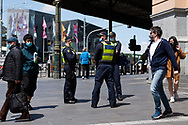 Protective Services police officers are seen at Flinders Street Station during COVID-19 in Melbourne, Australia. Premier Daniel Andrews announced today that some minor changes will be made to the current Stage 4 Restrictions in Melbourne. As yet, there is no sign of any meaningful change despite numbers of new cases being under 5 for the 14 day rolling average. Zero cases and no deaths were recorded in the past 24 hours in Victoria. (Photo by Dave Hewison/Speed Media)