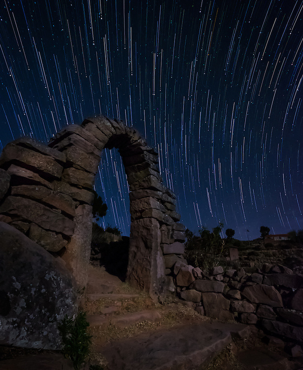 PUNO, PERU - CIRCA OCTOBER 2015:  Star trails over typical arch of the Island of Taquile in Lake Titicaca.