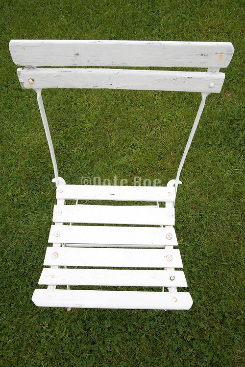 overhead view of a white painted folding garden chair