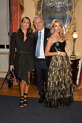 Left to right, MARIA BUCCELLATI, ANDREA BUCCELLATI and LUCREZIA BUCCELLATI at an evenig of Jewellery & Photography to launch the Buccellati 'Opera Collection' held at Spencer House, London on 21st October 2015.