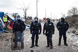 Licensed to London News Pictures. 03/03/2016. French riot police keep people away from the demolition zone. French authorities are clearing the southern half of the Calais 'Jungle' camp, which charities estimate to contain 3,500 people.. Photo credit : Rob Pinney/LNP