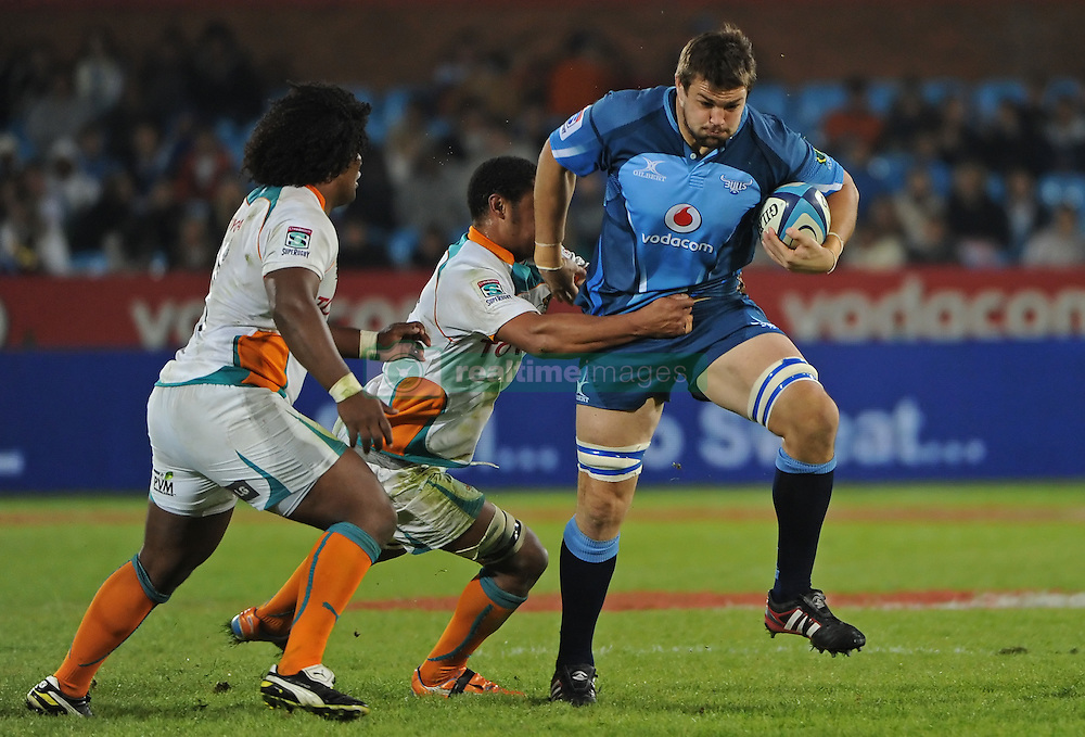 PRETORIA, South Africa, 28 May 2011. Flip van der Merwe of the Bulls is tackled by Ashley Johnson and Davon Raubenheimer of the Cheetahs during the Super15 Rugby match between the Bulls and the Cheetahs at Loftus Versfeld in Pretoria, South Africa on 28 May 2011..Photographer : Anton de Villiers / SPORTZPICS