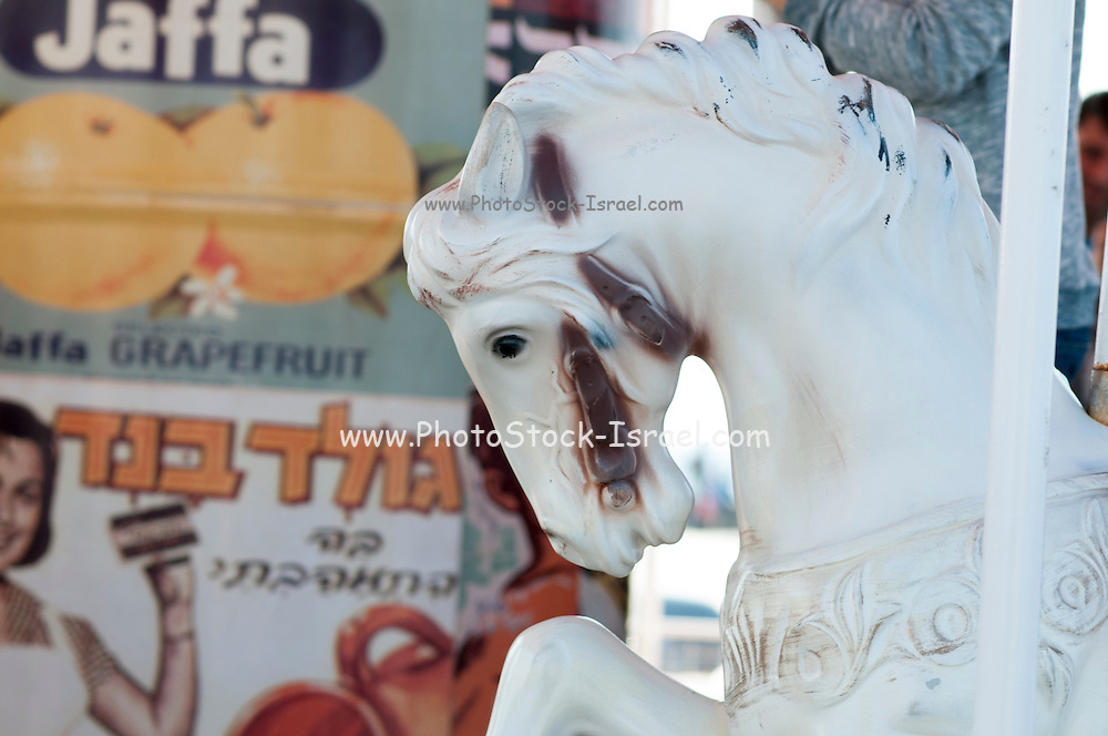 close up of a horse on a merry-go-round