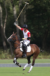 The Duke of Sussex plays polo in the Khun Vichai Srivaddhanaprabha Memorial Polo Trophy during the King Power Royal Charity Polo Day at Billingbear Polo Club, Wokingham, Berkshire.