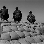 Aug 01, 2009 - Kandahar, Afghanistan - Afghan soldiers (ANA) sit on sand bags looking out over the Sperwan area from their Forward Operating Base just west of Kandahar City in Panjwai District, Kandahar Province, Afghanistan. .(Credit Image: © Louie Palu/ZUMA Press)