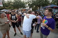 Nick Burger, center left, and Jeff Kruse embrace during a fundraiser after the Pulse nightclub shooting in Orlando, Fla., Thursday, June 23, 2016. (Phelan M. Ebenhack via AP)