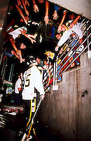 1999: Roller hockey player Todd Wetzel talks with fans in the tunnel before the  Anaheim Bullfrogs played a game at the Pond. Transparency image scan.