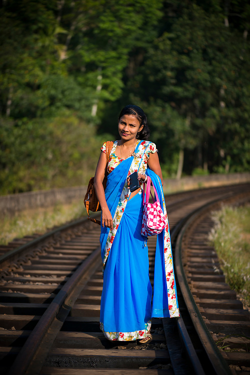 Portrait of a young Sri Lankan woman, pausing on her walk across the colonial-era Nine Arches Bridge, located on the outskirts of Ella, Sri Lanka. (April 11, 2017)
