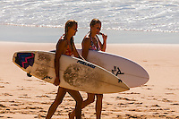 Female surfers walking on the beach, Manly Beach, Sydney, New South Wales, Australia