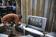 New and old - and a lot of non-working electronic goods such as TVs and computers come in to the market via Lagos harbour from the US, Western Europe and China. This picture is part of an undercover investigation by Greenpeace and Sky News.  A TV-set originally delivered to a municipality-run collecting point in UK for discarded electronic products was tracked and monitored by Greenpeace using a combination of GPS, GSM, and an onboard radiofrequency transmitter placed inside the TV-set.  The TV arrived in Lagos in container no 4629416 and was found in Alaba International Market and bought back by Greenpeace activist. The TV was subsequently brought back to England and used as proof of illegal export of electronic waste. A number of individual are currently on trial in London in connection with illegal exports(Nov 2011)