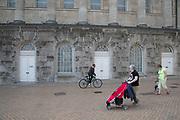 People passing Birmingham Town Hall in Birmingham, United Kingdom.