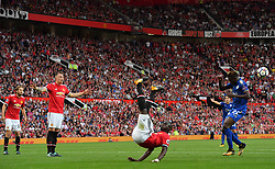 Manchester United's Eric Bailly acrobatically clears the ball