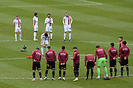 Scunthorpe United Alex Gilliead (8) lays a reef in remembrance of those who lost their lives at the Bradford fire during the EFL Sky Bet League 2 match between Bradford City and Scunthorpe United at the Utilita Energy Stadium, Bradford, England on 1 May 2021.