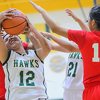 012015       Cable Hoover<br /> <br /> Thoreau Hawk Amber Ashley (12) is blocked by Shiprock Chieftain Shantai Gray (54) Tuesday at Thoreau High School.
