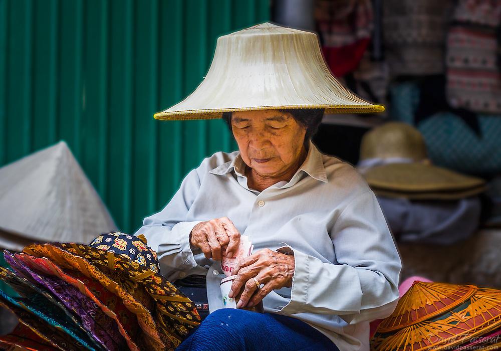 Thai hat seller cashing in her money.