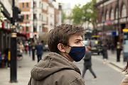Face masks are still being used by a large proportion of people as visitors come in to central London on 25th May 2021 in London, United Kingdom. As the coronavirus lockdown continues its process of easing restrictions, more and more people are coming to the West End as more businesses open.