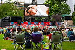 Edinburgh, Scotland, UK. 19th August  2021. Audience watch an outdoor screening of the cult movie Ferris Bueller's Day Off at the  Film Fest in the City outdoor cinema in St Andrew Square. This is one of the events taking place during the Edinburgh International Film Festival in the city.  Iain Masterton/Alamy Live news.