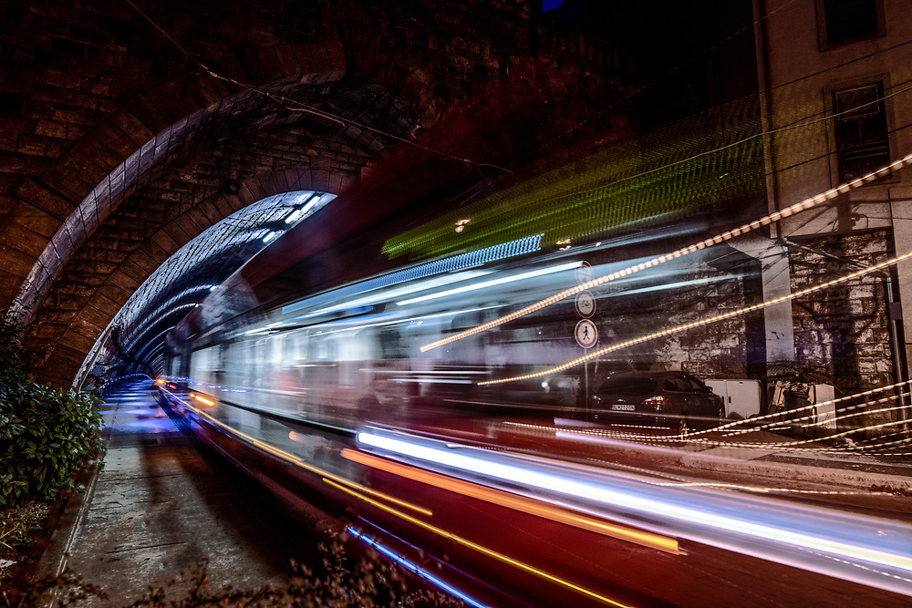 Moving tram exiting the tunnel below Bratislava castle