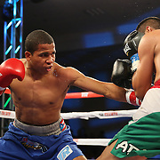 ORLANDO, FL - OCTOBER 04:  Felix Verdejo of Puerto Rico (L) throws a body shot to the belly of Sergio Villanueva of Mexico during their professional lightweight boxing match at the Bahía Shriners Auditorium & Events Center on October 4, 2014 in Orlando, Florida. (Photo by Alex Menendez/Getty Images) *** Local Caption *** Felix Verdejo; Sergio Villanueva