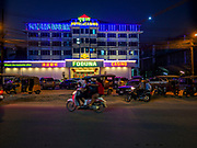 """13 FEBRUARY 2019 - SIHANOUKVILLE, CAMBODIA:  Traffic goes past the Foduna Casino and Hotel, a Chinese owned casino in Sihanoukville. There are about 80 Chinese casinos and resort hotels open in Sihanoukville and dozens more under construction. The casinos are changing the city, once a sleepy port on Southeast Asia's """"backpacker trail"""" into a booming city. The change is coming with a cost though. Many Cambodian residents of Sihanoukville  have lost their homes to make way for the casinos and the jobs are going to Chinese workers, brought in to build casinos and work in the casinos.      PHOTO BY JACK KURTZ"""