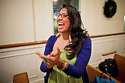19 DECEMBER 2010 - PHOENIX, AZ: DULCE JUAREZ, a student at Arizona State University, applauds a speaker at a prayer service for the DREAM Act in Phoenix. About 100 supporters of the DREAM Act gathered at First Congregational Church of Christ in Phoenix Sunday night, December 19, for a prayer vigil in support of the DREAM Act, which was defeated in the US Senate Saturday, Dec. 18. The DREAM Act, was supported by the Obama administration, and was an important part of the administration's immigration reform platform. The defeat of the DREAM Act, which would have established a path to citizenship for undocumented immigrants who were brought to the US by their parents when they were children, set back the President's immigration reform efforts. PHOTO BY JACK KURTZ