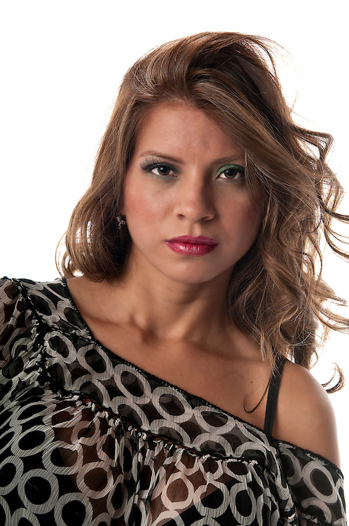 Portrait of attractive young hispanic woman looking.