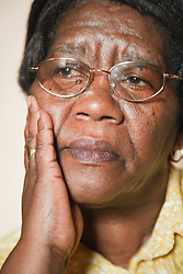 Portrait of old black lady looking thoughtful