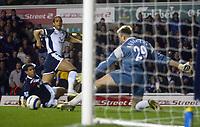 Mido comes close for Tottenham Hotspur.