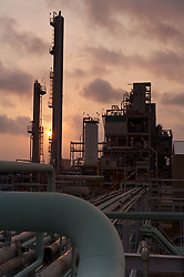 Stock photo of a refinery at sunset