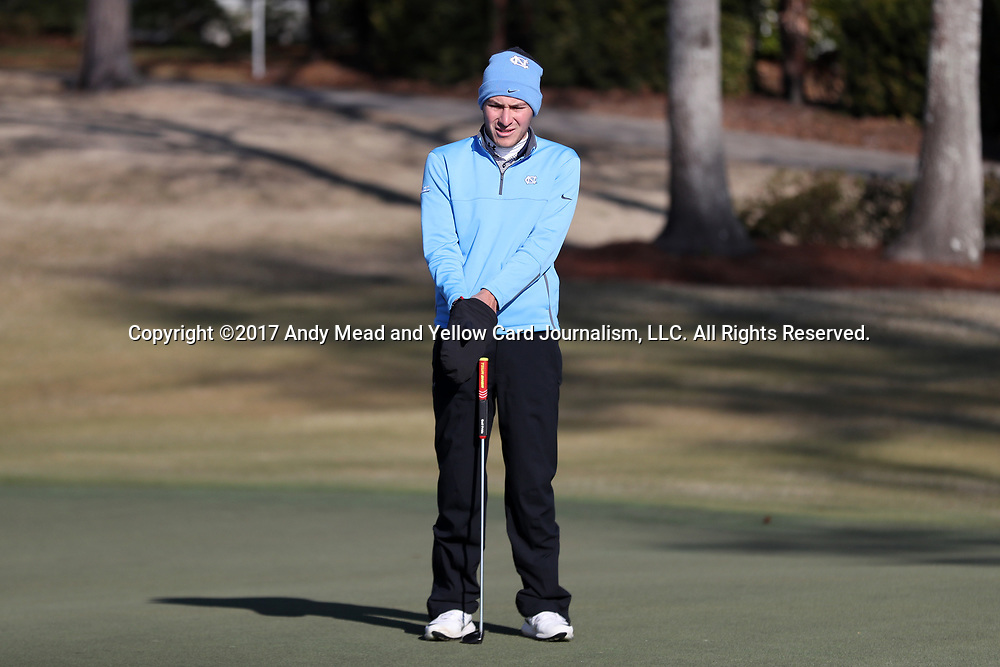 WILMINGTON, NC - MARCH 19: North Carolina's Jose Montano (BOL) waits on the green on the Ocean Course fourth hole. The first round of the 2017 Seahawk Intercollegiate Men's Golf Tournament was held on March 19, 2017, at the Country Club of Landover Nicklaus Course in Wilmington, NC.