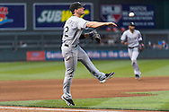 Conor Gillaspie #12 of the Chicago White Sox makes a leaping throw to 1st base against the Minnesota Twins on June 19, 2013 at Target Field in Minneapolis, Minnesota.  The Twins defeated the White Sox 7 to 4.  Photo: Ben Krause