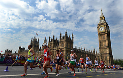 File photo dated 12-08-2012 of Runners in the Olympic marathon run past the Palace of Westminster in London.