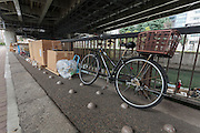 Bumps put in the ground to stop homeless people sleeping there by a riverside in Jinbocho, Tokyo, Japan. Wednesday January 6th 2016