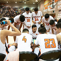 Gallup Bengals head coach Joshua Dunlap calls a time out during the championship game against Spring Valley Saturday night at the Gallup Invitational boys basketball tournament at Gallup High School.