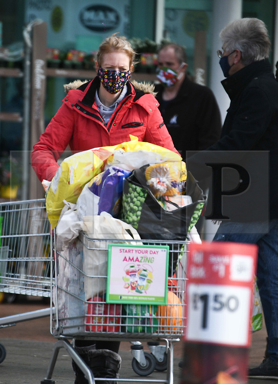 © Licensed to London News Pictures. 23/10/2020. City, UK. People shop at a Asda supermarket in Cardiff, Wales, as it is announced that only essential items will be on sale during the seventeen-day-long 'Firebreak Lockdown' in Wales. Photo credit: Robert Melen/LNP