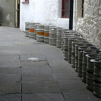 Europe, Ireland, Westport. Kegs in an alley.