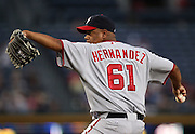 ATLANTA, GA - AUGUST 30:  Pitcher Livan Hernandez #61 of the Washington Nationals throws a pitch during the game against the Atlanta Braves at Turner Field on August 30, 2011 in Atlanta, Georgia.  (Photo by Mike Zarrilli/Getty Images)