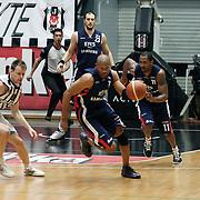 Besiktas's Brad NEWLEY (L), Fedor LIKHOLITOV (R) and Efes Pilsen's Charles SMITH (2ndL) Bootsy THORNTON (2ndR), Ermal KURTOGLU (B) during their Turkish Basketball league Play Off semi final second leg match Besiktas between Efes Pilsen at the BJK Akatlar Arena in Istanbul Turkey on Wednesday 12 May 2010. Photo by Aykut AKICI/TURKPIX