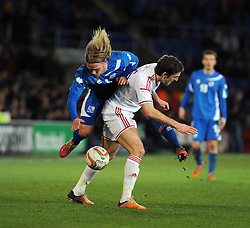 Birkir Bjarnason (Sampdoria) of Iceland is fouled by Samuel Ricketts of Wales (wolves) - Photo mandatory by-line: Dougie Allward/JMP - Tel: Mobile: 07966 386802 03/03/2014 -