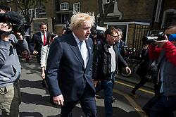 © London News Pictures. 07/05/2015. Mayor of London BORIS JOHNSON surrounded by media as he leaves his local polling station in Islington, North London, after voting on the day that the UK goes to the polls in the 2015 general election. Photo credit: Ben Cawthra/LNP